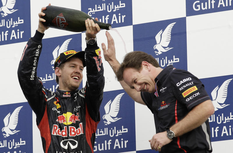Red Bull driver Sebastian Vettel of Germany, left, winner, and Red Bull team principal Christian Horner celebrates with rose water after winning on the podium after the Bahrain Formula One Grand Prix at the Bahrain International Circuit in Sakhir, Bahrain, Sunday, April 22, 2012. (AP Photo/Hassan Ammar)