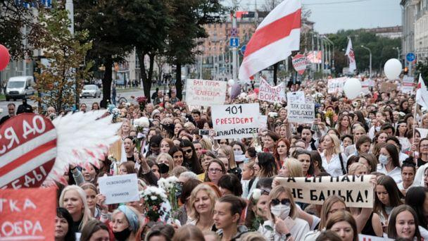 PHOTO: Women hold signs as they walk during a demonstration against police brutality following recent protests to reject the presidential election results in Minsk, Belarus, Aug. 29, 2020. (Belapan via Reuters)