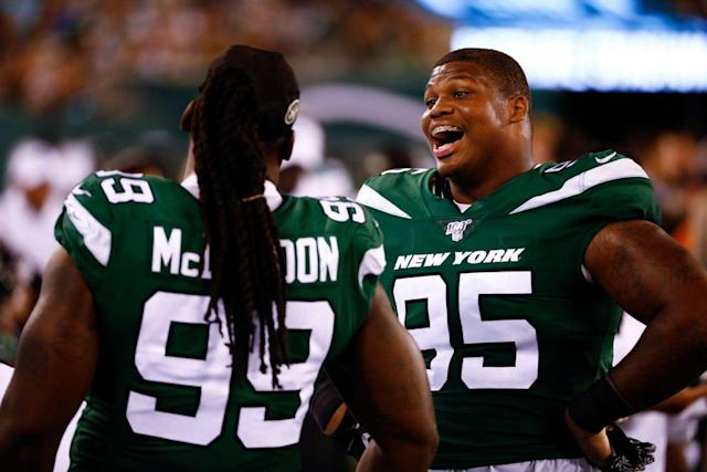 Axes in the locker room? Why Jets' defensive linemen have 'warrior sticks' mixed in with their shirts and shoes