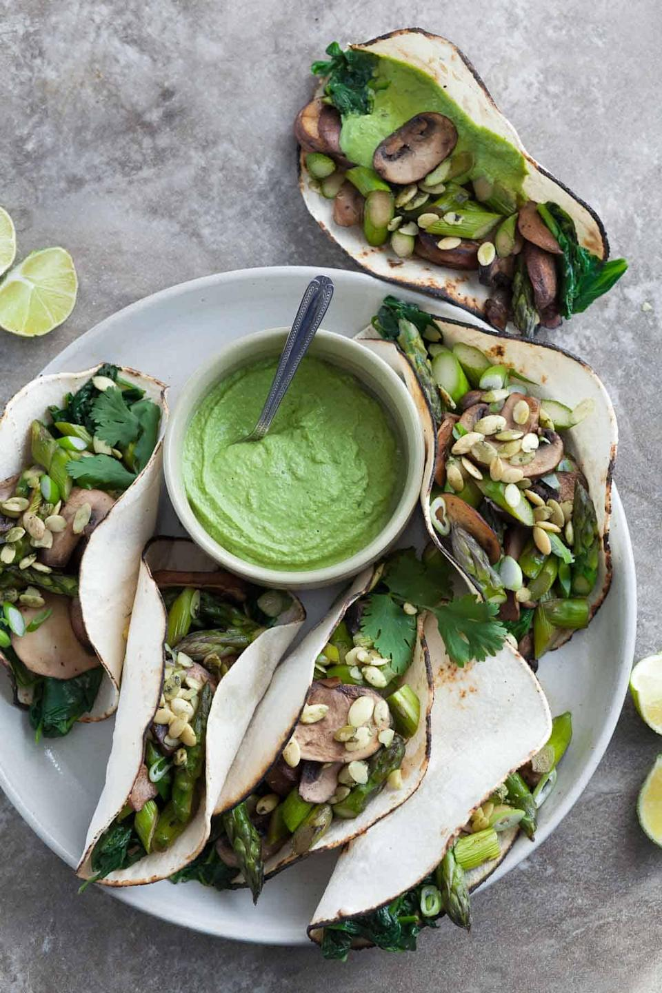 """<p>All the green goodness—asparagus, spinach, jalepeño, cilantro—packs these tacos with bright and fresh flavor. </p> <p>Get the recipe <a href=""""https://gourmandeinthekitchen.com/mushroom-asparagus-tacos-with-jalapeno-cashew-crema-paleo-vegan/"""" rel=""""nofollow noopener"""" target=""""_blank"""" data-ylk=""""slk:here"""" class=""""link rapid-noclick-resp"""">here</a>.</p>"""
