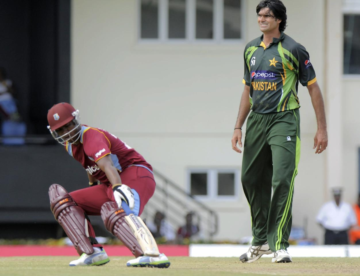 West Indies opening batsman Johnson Charles (L) gets 4 runs off Pakistan bowler Mohammad Irfan (R) on July 24, 2013 at the start of the 5th and final ODI West Indies v Pakistan at Beausejour Cricket Ground, in Gros Islet, St. Lucia. AFP PHOTO/RANDY BROOKS        (Photo credit should read RANDY BROOKS/AFP/Getty Images)