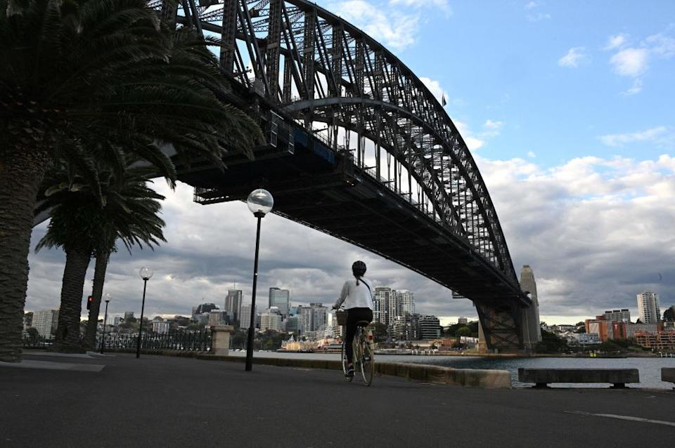 A resident rides a bike along the Sydney Harbour during the lockdown.