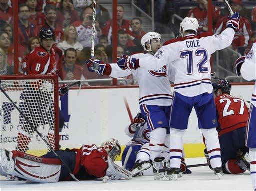 Montreal Canadiens right wing Erik Cole (72) is congratulated by teammate center David Desharnais (51) after he scored a goal against Washington Capitals goalie Michal Neuvirth, left, during the first period of an NHL hockey game on Saturday, March 31, 2012 in Washington. (AP Photo/Evan Vucci)