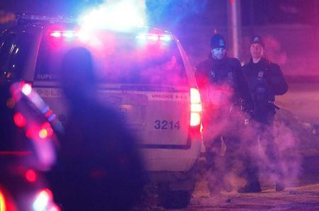 Police officers are seen near a mosque after a shooting in Quebec City. REUTERS/Mathieu Belanger