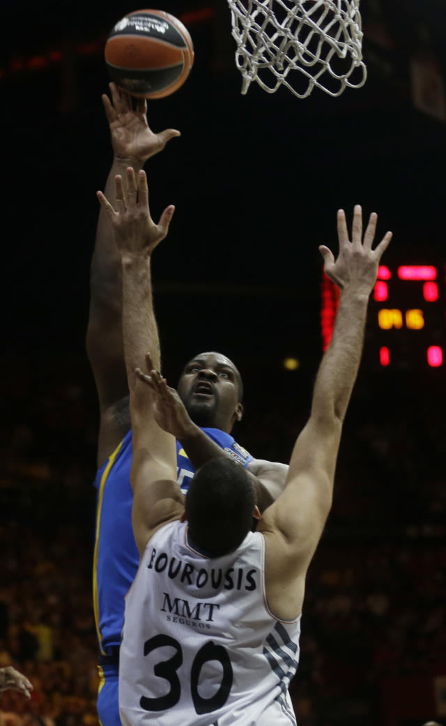 Maccabi Tel Aviv's Sofoklis Schortsanitis, fires a shot as Real Madrid's Ioannis Bourousis jumps during the Euroleague Final Four final match between Real Madrid and Maccabi of Tel Aviv, in Milan, Italy, Sunday, May 18, 2014. (AP Photo/Luca Bruno)