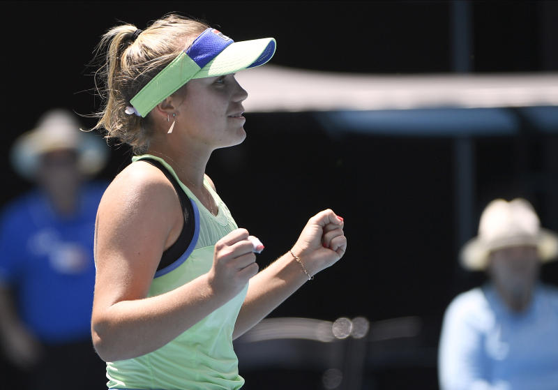 Sofia Kenin of the U.S. celebrates her win over Tunisia's Ons Jabeur in their quarterfinal match at the Australian Open tennis championship in Melbourne, Australia, Tuesday, Jan. 28, 2020. (AP Photo/Andy Brownbill)