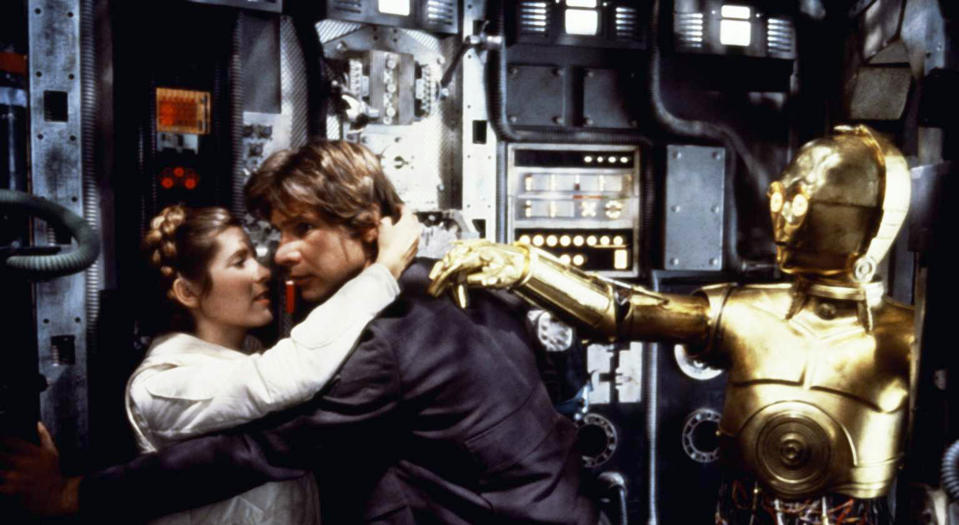 American actors Carrie Fisher, Harrison Ford and British Anthony Daniels on the set of Star Wars: Episode V - The Empire Strikes Back directed by Irvin Kershner. (Photo by Lucasfilm/Sunset Boulevard/Corbis via Getty Images)