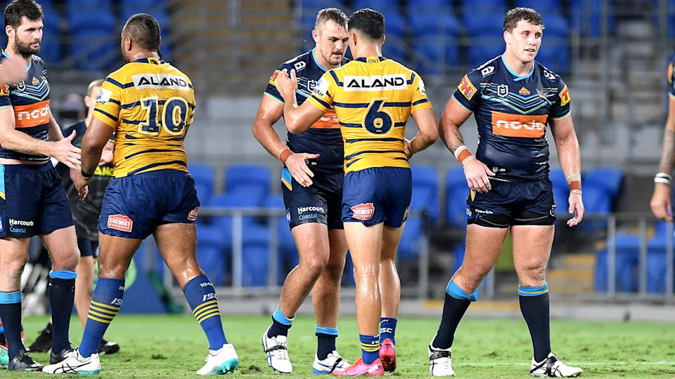 Gold Coast Titans and Parramatta Eels players, pictured here shaking hands after their match on Sunday night.