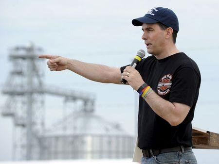"""Wisconsin Governor Walker speaks during a """"Roast & Ride"""" campaign event sponsored by Iowa Senator Ernst at the Central Iowa Expo in Boone, Iowa"""