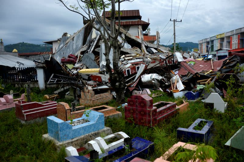 General view of collapsed buildings following an earthquake in Mamuju, West Sulawesi