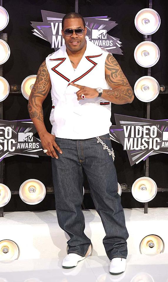 """A beefed up Busta Rhymes bared his arms -- and his many, many tattoos -- in a bright white vest and jeans. Jason Merritt/<a href=""""http://www.gettyimages.com/"""" target=""""new"""">GettyImages.com</a> - August 28, 2011"""