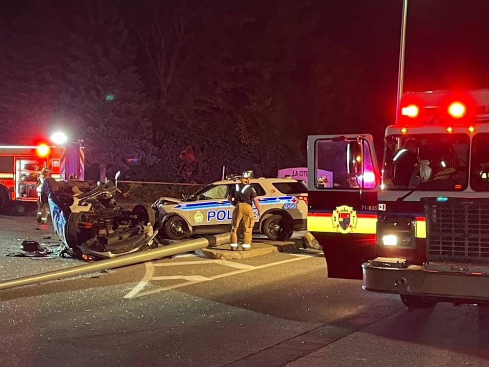 Firefighters say one person had to be extricated from a vehicle after a crash involving an Ottawa police vehicle on Aviation Parkway at Privé La Cité Saturday night. One car can be seen on its roof, while the police cruiser has front-end damage. (Submitted by S.B. - image credit)