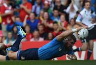 Italy's Michele Rizzo scores a try against Canada in their Pool D match at Elland Road on September 26, 2015 (AFP Photo/Paul Ellis)
