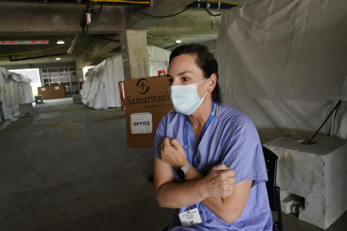 Kelly Sites, a nurse and team leader with the Samaritan's Purse International Relief medical team in Jackson, Miss., recalls the look of fear she has seen on the faces of some patients she has worked with, Wednesday, Aug. 25, 2021. Sites has been deployed on 22 medical missions in 12 years with the nondenominational evangelical Christian organization that provides spiritual and medical aid internationally and domestically. (AP Photo/Rogelio V. Solis)