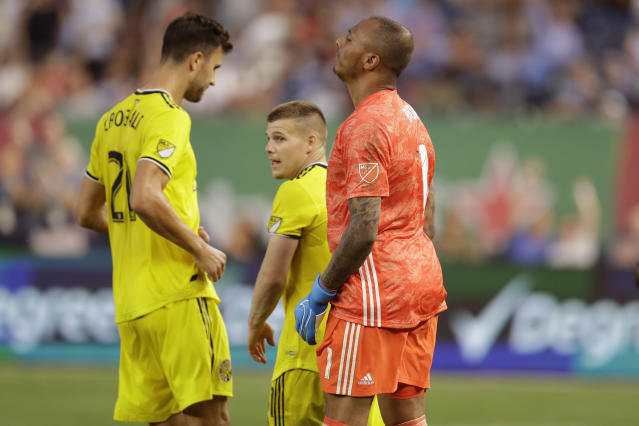 Columbus Crew defender Alex Crognale (21), left, and Crew goalkeeper Elroy Room, right, react after Columbus gave up a goal to New York City FC midfielder Valentin Castellanos (not shown) during the first half of an MLS soccer match, Wednesday, Aug. 21, 2019, in New York. (AP Photo/Kathy Willens)