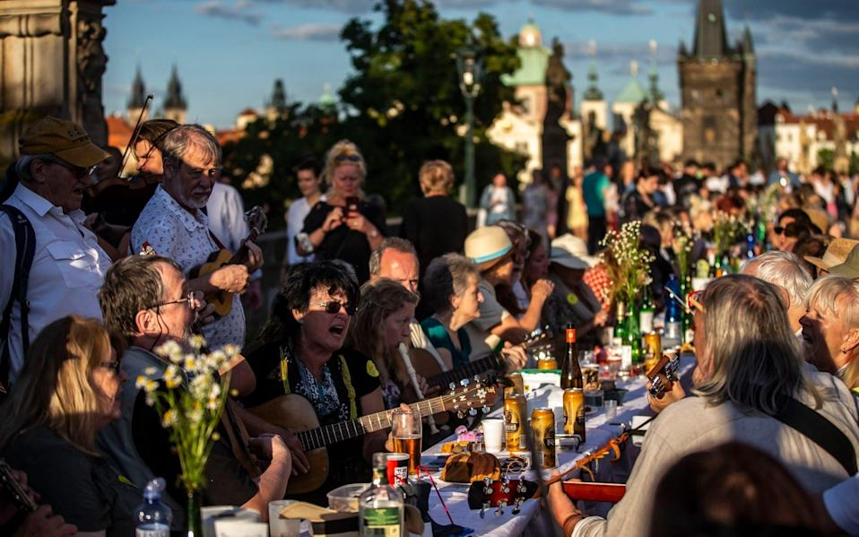 Residents sit to dine on a 500 meter long table set on the Charles Bridge - Getty Images Europe