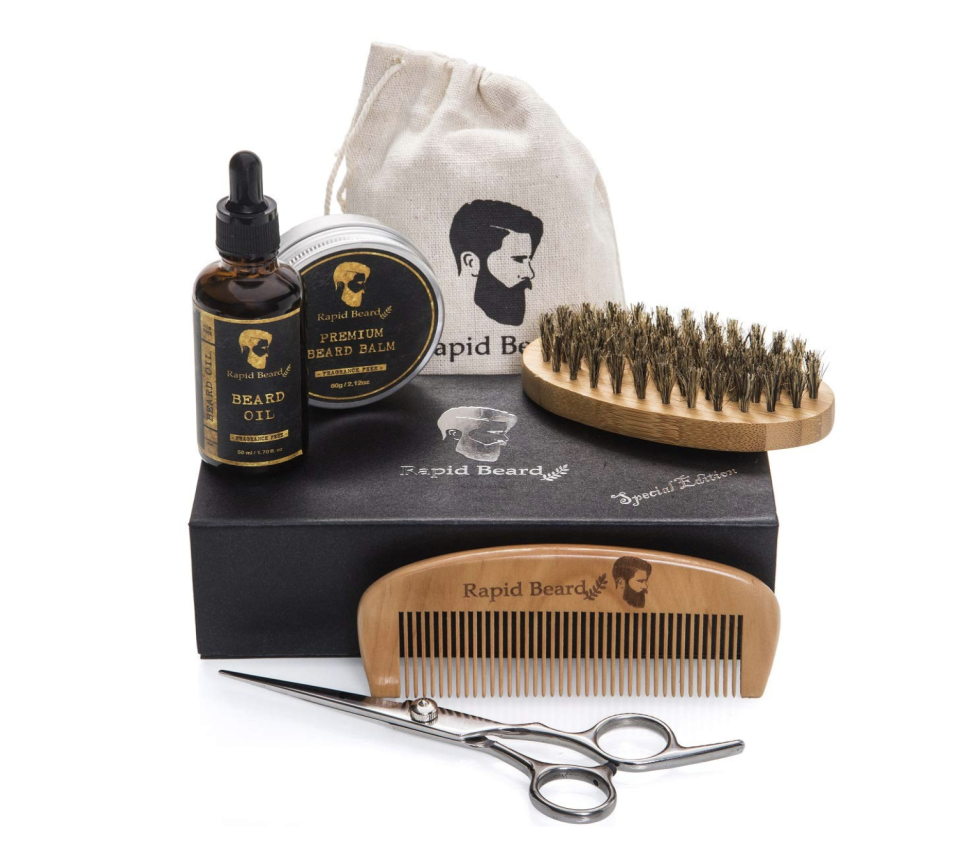 """<p><strong>Rapid Beard</strong></p><p>amazon.com</p><p><strong>$29.97</strong></p><p><a href=""""https://www.amazon.com/dp/B071RTF9HN?tag=syn-yahoo-20&ascsubtag=%5Bartid%7C10065.g.1290%5Bsrc%7Cyahoo-us"""" rel=""""nofollow noopener"""" target=""""_blank"""" data-ylk=""""slk:Shop Now"""" class=""""link rapid-noclick-resp"""">Shop Now</a></p><p>You <em>love </em>his beard. Help him keep it groomed and soft with this kit.</p>"""