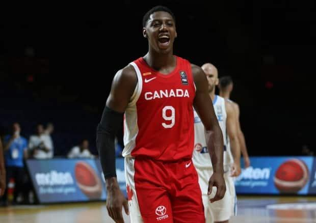 Canada's RJ Barrett celebrates following the team's 97-91 win over Greece to open the last-chance Olympic basketball qualifier on Tuesday in Victoria. (Chad Hipolito/The Canadian Press - image credit)