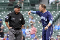 CORRECTS UMPIRE NAME TO TOM HALLION, NOT PHIL CUZZI - Chicago Cubs bench coach Andy Green, right, argues with umpire Tom Hallion after Hallion ejected Green during the sixth inning of a baseball game Friday, Sept. 3, 2021, in Chicago. Green took the helm of the team since manager David Ross and president of baseball operations Jed Hoyer have tested positive for COVID-19. (AP Photo/Charles Rex Arbogast)
