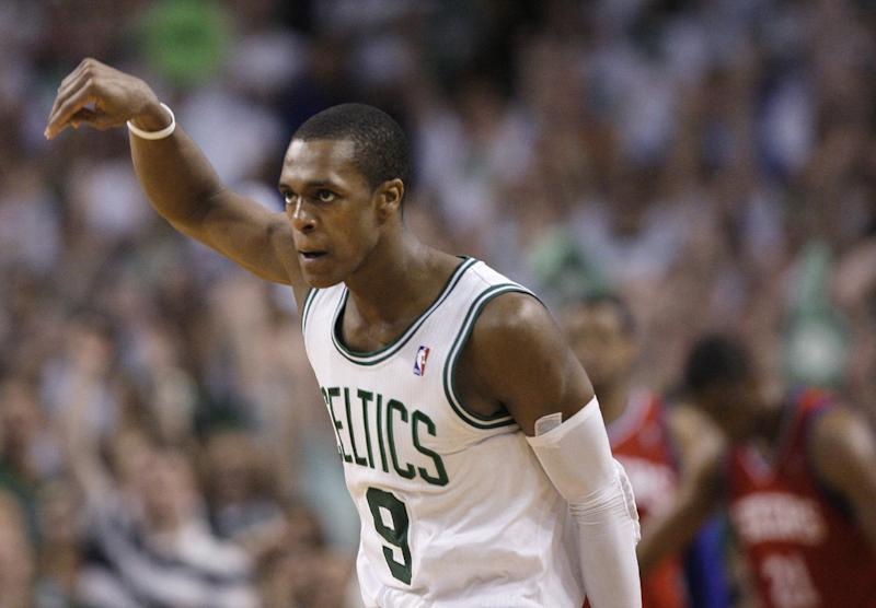 Boston Celtics guard Rajon Rondo gestures after making a 3-point basket during the fourth quarter of Game 7 against the Philadelphia 76ers in an NBA basketball Eastern Conference semifinal playoff series, Saturday, May 26, 2012, in Boston. The Celtics won 85-75 to advance to the conference finals against the Miami Heat. (AP Photo/Elise Amendola)
