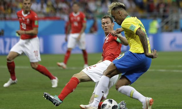 Stephan Lichtsteiner challenges Neymar during Switzerland's 1-1 draw with Brazil in Rostov on Sunday.