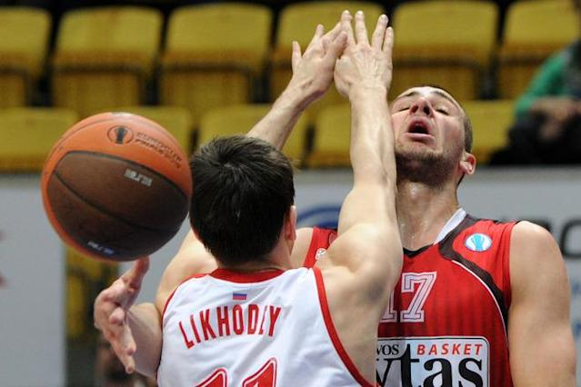 Lietuvos Rytas' Jonas Valanciunas (R) vies with BC Spartak Saint-Petersburg's Valery Likhodey during Eurocup's FinalFour third place basketball match between Lietuvos Rytas and BC Spartak Saint-Petersburg in Khimki, a suburb of Moscow, on April 15, 2012. (Photo by Kirill Kudryavtsev /AFP/Getty Images)