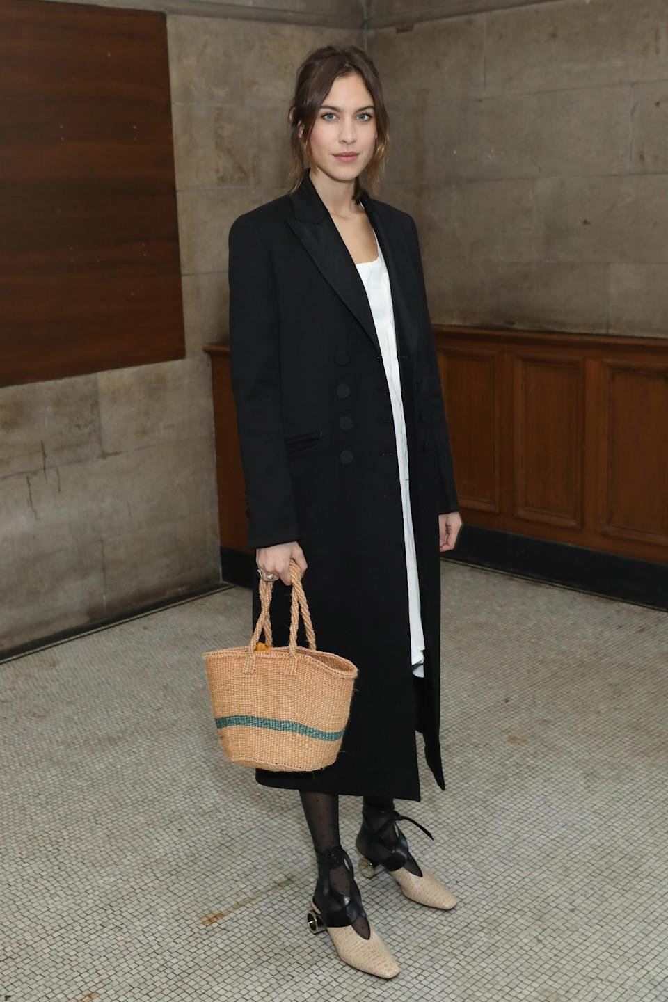 <p>Alexa Chung made her LFW debut in a tailored black coat and sophisticated shoes. <i>[Photo: Getty]</i> </p>