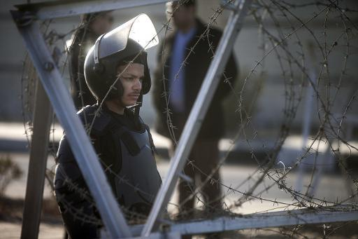 An Egyptian riot policeman stands guard in Cairo on February 5, 2014