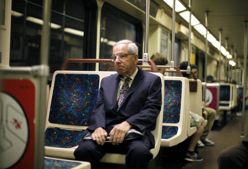 Shareholder activist John Chevedden, 67, rides the subway to the DreamWorks Animation SKG Inc stockholder meeting in Hollywood, California May 29, 2013. Chevedden has quietly transformed corporate America. Using shareholder proxy measures, the retired aerospace worker helped convince big companies to change the way they elect directors or give shareholders more of a say in executive pay. Picture taken May 29, 2013. To match special report ACTIVIST-CHEVEDDEN/ REUTERS/Lucy Nicholson (UNITED STATES - Tags: ENTERTAINMENT BUSINESS)