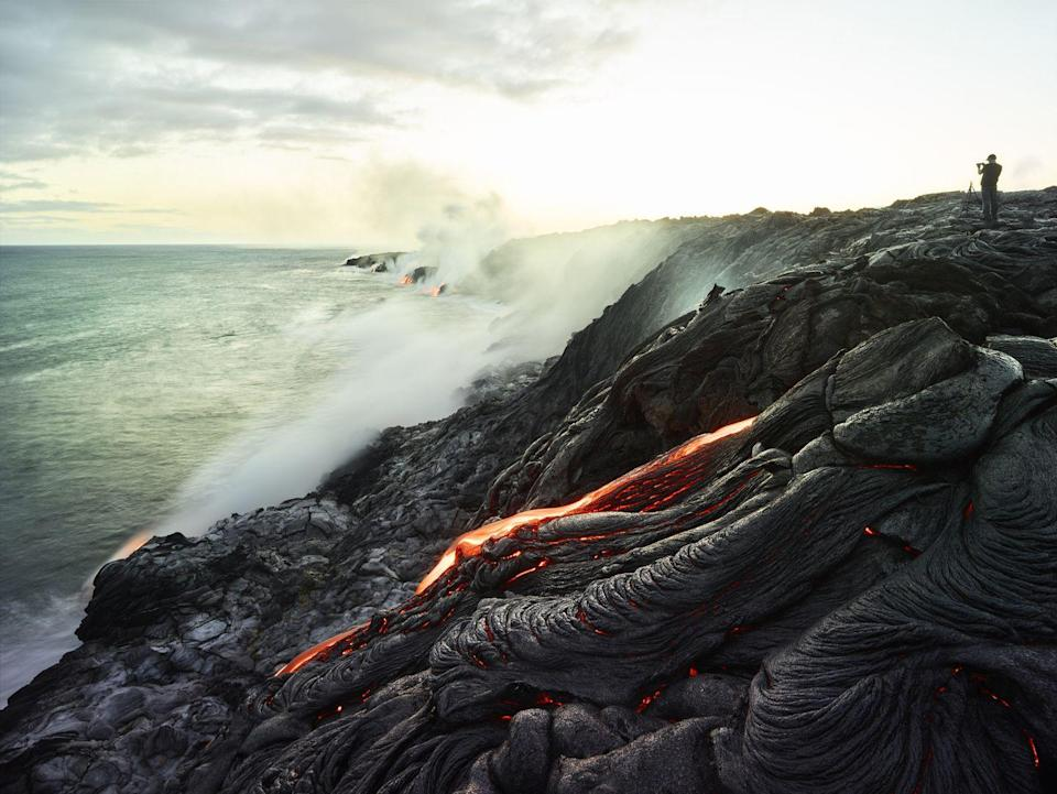 """<p><a href=""""https://www.nps.gov/havo/index.htm"""" rel=""""nofollow noopener"""" target=""""_blank"""" data-ylk=""""slk:Hawai'i Volcanoes"""" class=""""link rapid-noclick-resp""""><strong>Hawai'i Volcanoes </strong></a></p><p>Normally you'd run far away from an active volcano, but here you can sometimes see the lava slowly flow like a river into the ocean. When the lava isn't flowing, you can still see the amazing craters and unusual terrain that they've left in their wake. </p>"""