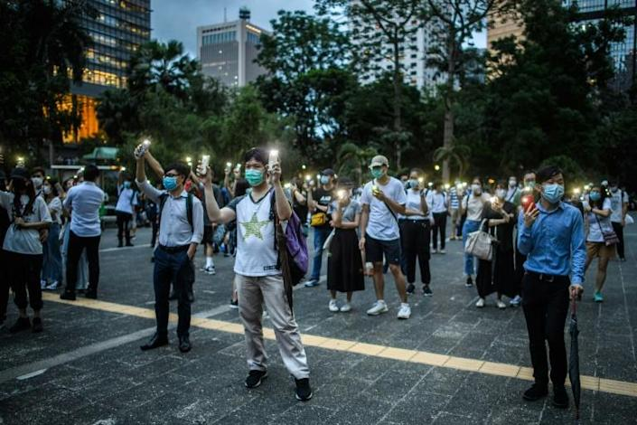 Defiant crowds a few-thousand strong gathered evening in the city's upmarket Central district to march and chant slogans (AFP Photo/ANTHONY WALLACE)