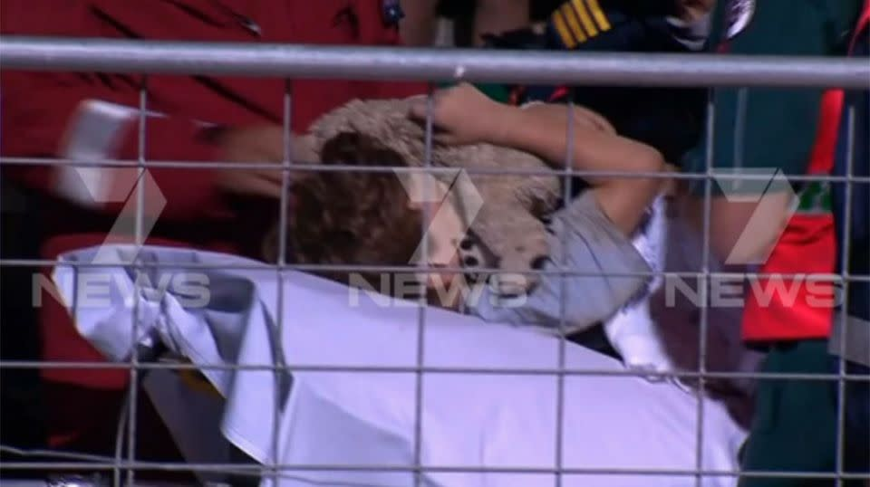 Clutching his teddy bear, the boy was pulled from the trench and flown to hospital. Source: 7 News