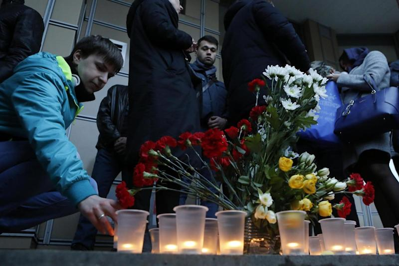 In memory: People light candles at an entrance of Sennaya subway station (AP)