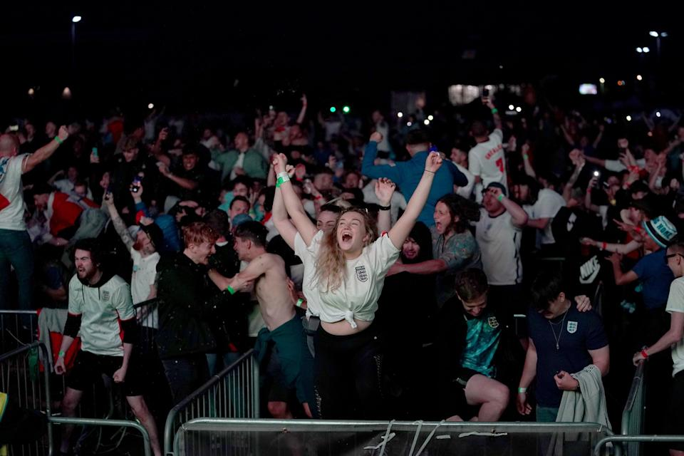 Fans in Manchester celebrate England qualifying for the Euro 2020 final (PA Wire)