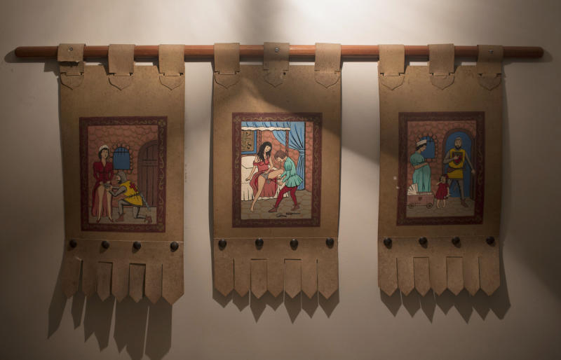 "Paintings of knights and noblemen unlocking women's chastity belts decorate the wall of the Medieval Room at the Shalimar Hotel, known as a love hotel in Rio de Janeiro, Brazil, Thursday, Jan. 17, 2013. With the arrival of next year's World Cup soccer tournament and the 2016 Olympic Games to this seaside city, local officials are scrambling to bridge a chronic hotel bed shortage so severe that during a UN conference here last year, the mayor had to appeal to residents to open their apartments to visitors. The plan? Slash property taxes for love hotels, known as ""motels"" in Portuguese, that agree to tone down the decor and free up 90 percent of their rooms for the tsunami of visitors expected to flood the city. (AP Photo/Felipe Dana)"