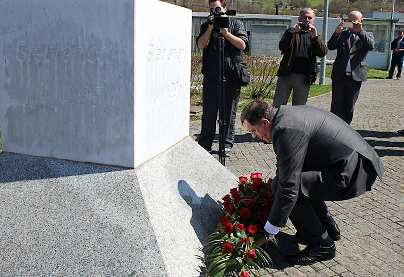 President of the Republika Srpska (the Bosnian Serb entity) Milorad Dodik lays flowers at the memorial cemetery in Potocari, near Srebrenica, on April 16, 2015 (AFP Photo/-)