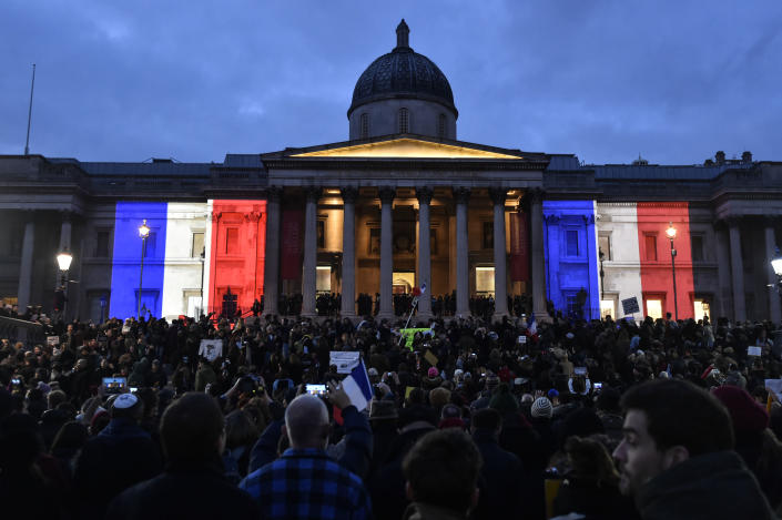 London's National Gallery is lit up in the colours of the French flag as crowds gather in Trafalgar Square (AFP Photo/Niklas Halle'n)
