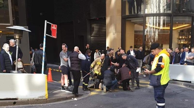 Handout photo taken with permission from the Twitter feed of @thisisbrodie of a man being tackled with a milk crate and chairs by members of the public in Sydney, Australia.