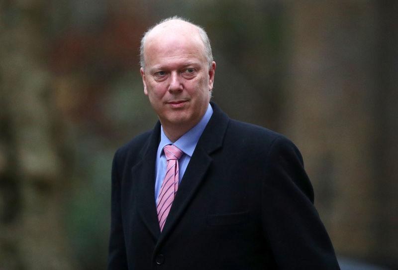 Britain's Secretary of State for Transport Chris Grayling arrives in Downing Street, London