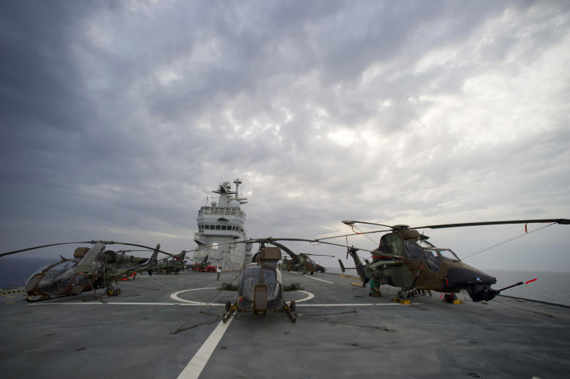 In this photo made available by French Army Saturday June 4, 2011,  combat helicopters are prepared on the deck of French navy  vessel  BPC Tonnerre in the Mediterranean sea.  British Apache and French attack helicopters struck targets for the first time in NATO's campaign in Libya, hitting Moammar Gadhafi's troops early Saturday near a key coastal oil town, the alliance said. Hours later, at least eight airstrikes were heard in Tripoli. (AP Photo/Arnaud Roine/ECPAD) NO SALES.