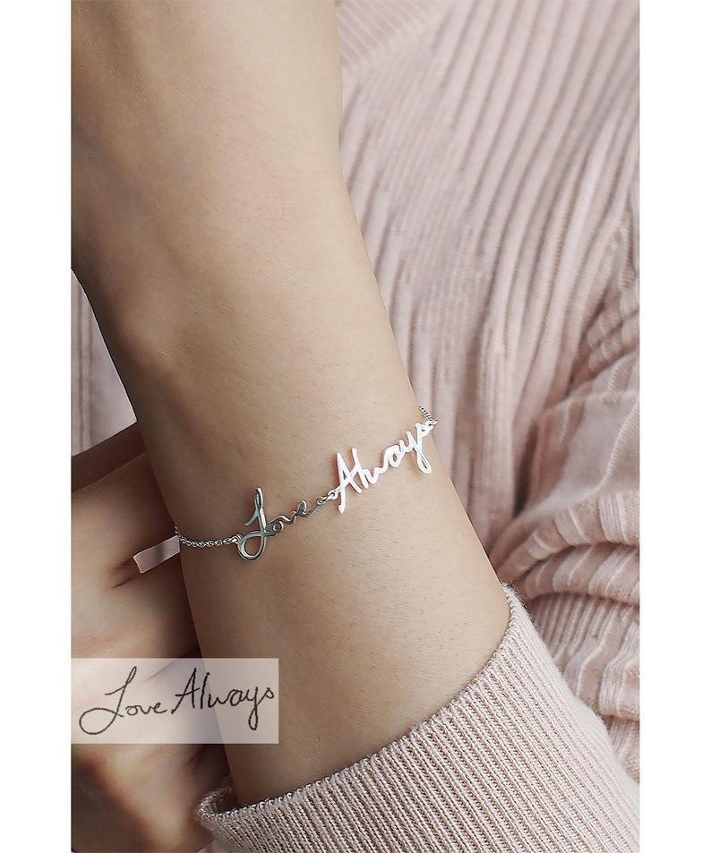 """<p><strong>IMEJEWELRY</strong></p><p>etsy.com</p><p><strong>$38.25</strong></p><p><a href=""""https://go.redirectingat.com?id=74968X1596630&url=https%3A%2F%2Fwww.etsy.com%2Fca%2Flisting%2F249296281%2Fhandwriting-bracelet-hb16f&sref=https%3A%2F%2Fwww.housebeautiful.com%2Fentertaining%2Fholidays-celebrations%2Fg4092%2Fvalentines-day-gifts-for-her%2F"""" rel=""""nofollow noopener"""" target=""""_blank"""" data-ylk=""""slk:BUY NOW"""" class=""""link rapid-noclick-resp"""">BUY NOW</a></p><p>Or, go the personalized route with this handwriting bracelet, based on a real photo of your handwritten message. </p>"""