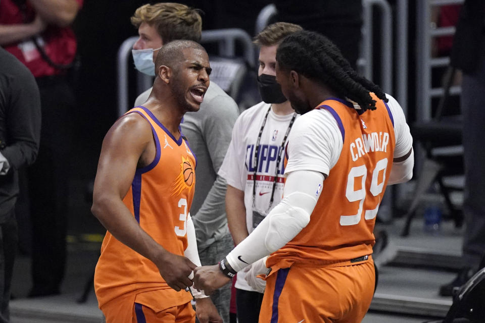 Phoenix Suns guard Chris Paul, left, and forward Jae Crowder celebrates as time runs out in Game 6 of the NBA basketball Western Conference Finals against the Los Angeles Clippers Wednesday, June 30, 2021, in Los Angeles. The Suns won the game 130-103 to take the series 4-2. (AP Photo/Mark J. Terrill)