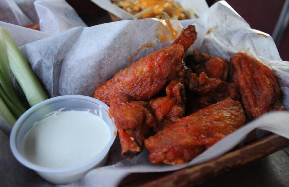"<p>In a town known for great wings, the ones at Wogies have risen above the pack. This classic sports bar serves delicious wings with no frills — they're crunchy, spicy, perfectly sauced and addictive. The heat level is spot-on. Along with a good beer selection and a great vibe, there's simply not much else you can want from <a href=""https://www.thedailymeal.com/drink/best-sports-bars-america-gallery?referrer=yahoo&category=beauty_food&include_utm=1&utm_medium=referral&utm_source=yahoo&utm_campaign=feed"">a great sports bar</a>.</p>"