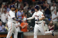 Houston Astros' Myles Straw (3) celebrates with Martin Maldonado after hitting a home run against the Texas Rangers during the fourth inning of a baseball game Wednesday, June 16, 2021, in Houston. (AP Photo/David J. Phillip)