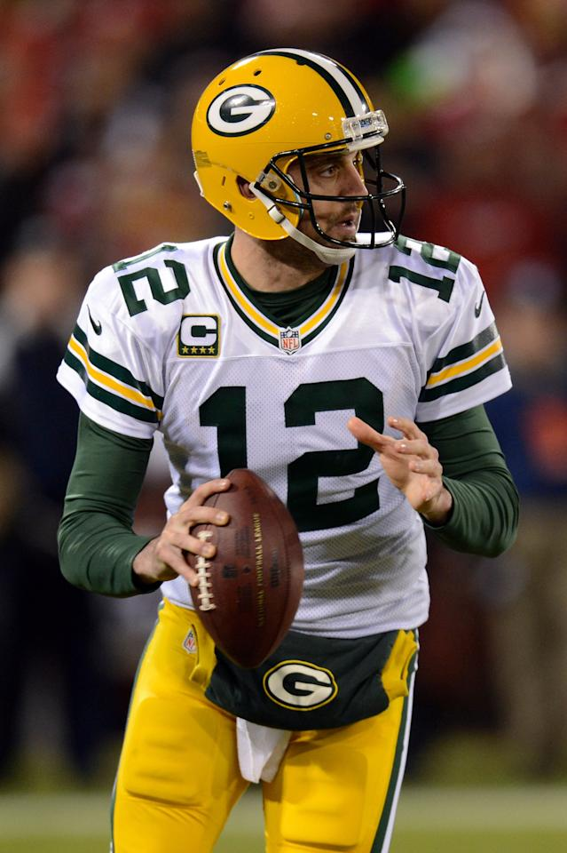 SAN FRANCISCO, CA - JANUARY 12:  Quarterback Aaron Rodgers #12 of the Green Bay Packers throws the ball against the San Francisco 49ers during the NFC Divisional Playoff Game at Candlestick Park on January 12, 2013 in San Francisco, California.  (Photo by Thearon W. Henderson/Getty Images)