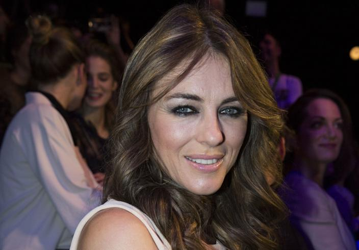 """In the early 2000s, Bing was involved in two sensational paternity cases, including one with British actress Elizabeth Hurley, with whom he had a son. <span class=""""copyright"""">(Gero Breloer / Associated Press)</span>"""