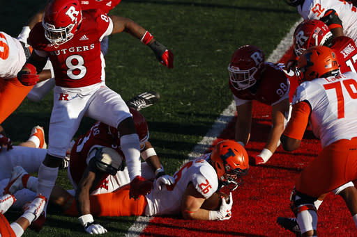 Illinois running back Mike Epstein (26) scores a touchdown past Rutgers linebacker Tyshon Fogg (8) during the second half of an NCAA college football game, Saturday, Nov. 14, 2020, in Piscataway, N.J. (AP Photo/Adam Hunger)