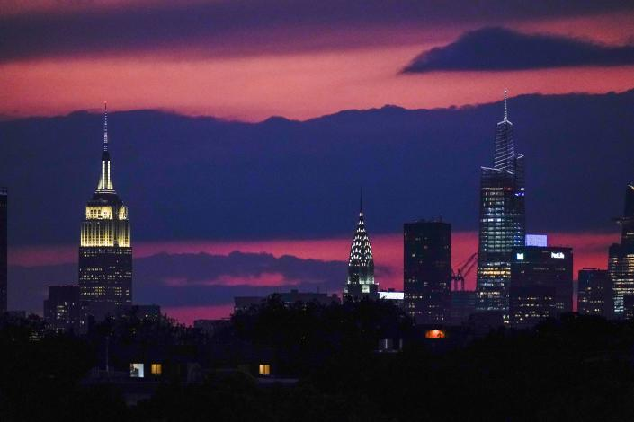 The sun sets behind midtown Manhattan Tuesday, Sept. 28, 2021, in New York. (AP Photo/Frank Franklin II)