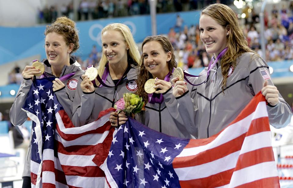 """United States' 4 x 100-meter medley relay team from left, <a href=""""http://sports.yahoo.com/olympics/swimming/allison-schmitt-1133648/"""" data-ylk=""""slk:Allison Schmitt"""" class=""""link rapid-noclick-resp"""">Allison Schmitt</a>, <a href=""""http://sports.yahoo.com/olympics/swimming/dana-vollmer-1130693/"""" data-ylk=""""slk:Dana Vollmer"""" class=""""link rapid-noclick-resp"""">Dana Vollmer</a>, <a href=""""http://sports.yahoo.com/olympics/swimming/rebecca-soni-1131469/"""" data-ylk=""""slk:Rebecca Soni"""" class=""""link rapid-noclick-resp"""">Rebecca Soni</a> and <a href=""""http://sports.yahoo.com/olympics/swimming/missy-franklin-1132902/"""" data-ylk=""""slk:Missy Franklin"""" class=""""link rapid-noclick-resp"""">Missy Franklin</a> pose with their gold medals at the Aquatics Centre in the Olympic Park during the 2012 Summer Olympics in London, Saturday, Aug. 4, 2012. (AP Photo/Lee Jin-man)"""
