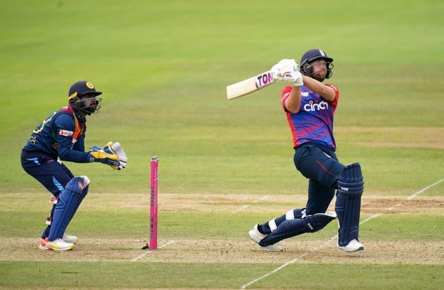 Dawid Malan hits a six as his innings guided England to a T20 victory over Sri Lanka